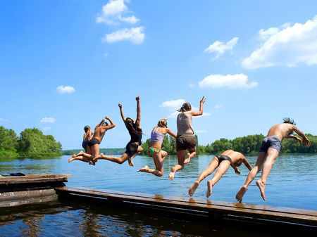 Jumping off for vacation in lake